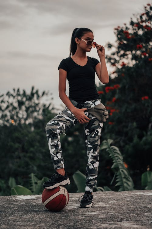 Photo Of Woman Wearing Camouflage Pants