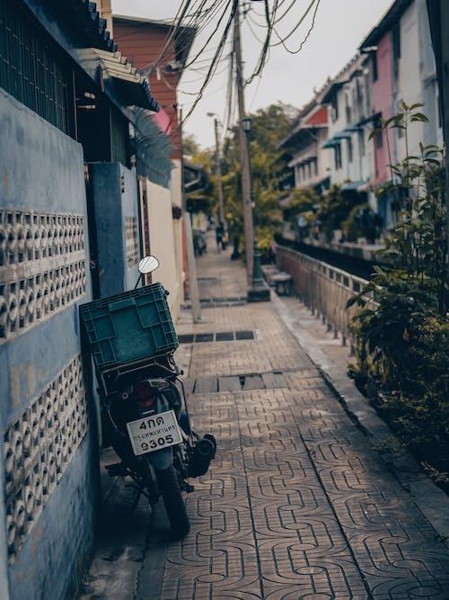Black Motorcycle Parked on Sidewalk