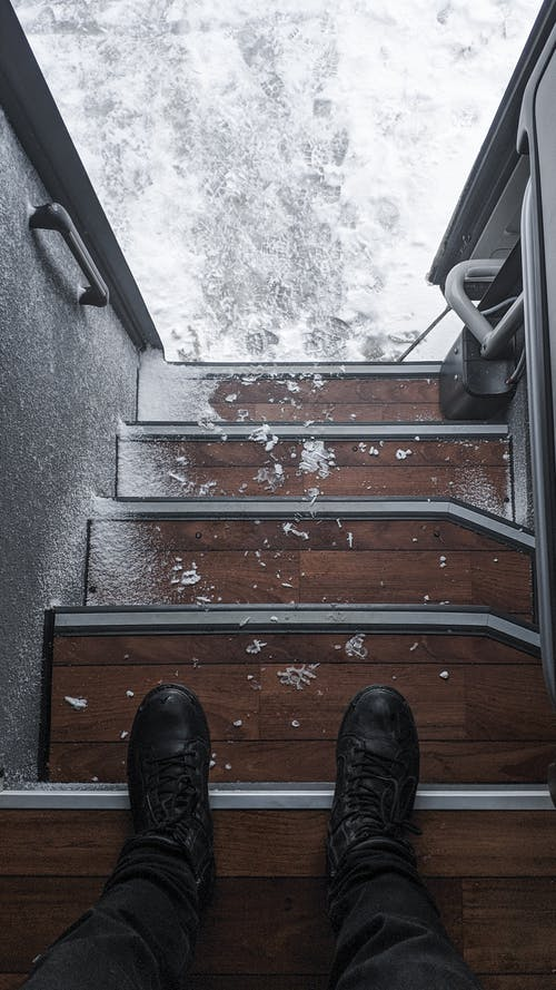 Photo Of Person Standing On Staircase