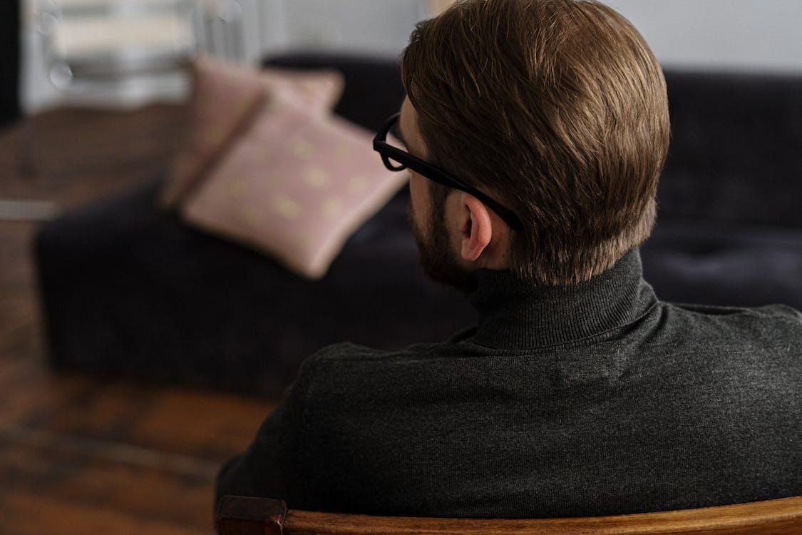 Man in Black Sweater Wearing Black Framed Eyeglasses