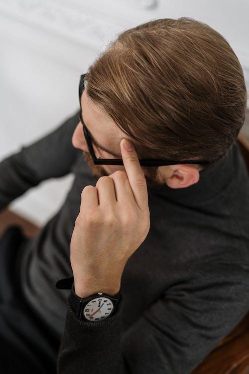 Man in Black Long Sleeve Shirt Wearing Black Watch