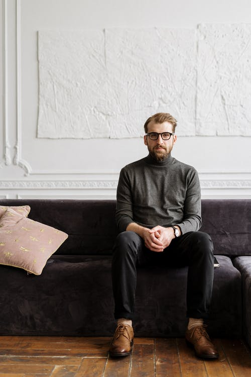 Man in Gray Sweater Sitting on Couch