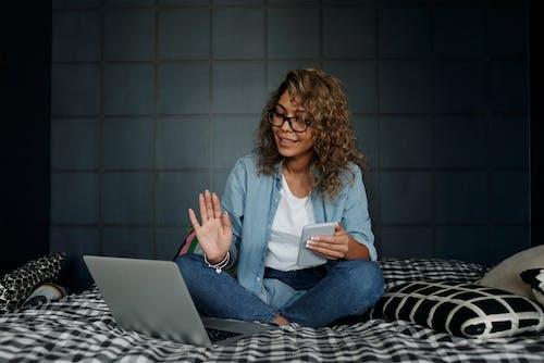 Photo Of Woman Wearing Denim Jeans