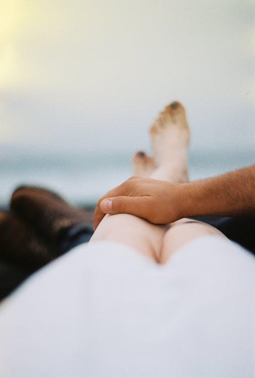 Man's Hand on a Woman's leg