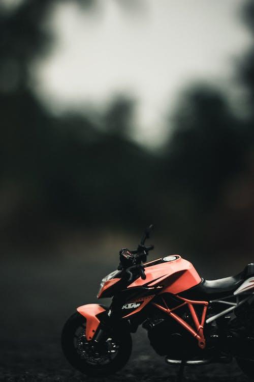 Miniature of motorbike on road against trees