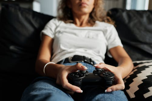 Photo Of Woman Using Game Controller