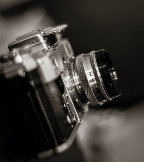 Retro photo camera with lens and flash