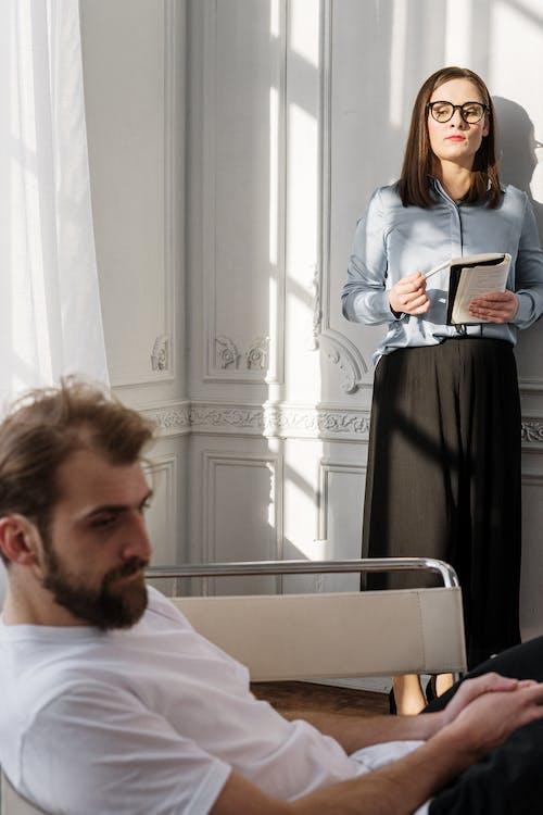 Man in White Dress Shirt Holding Black Tablet Computer