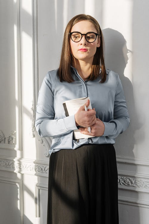 Woman in Blue Long Sleeve Shirt Wearing Black Framed Eyeglasses