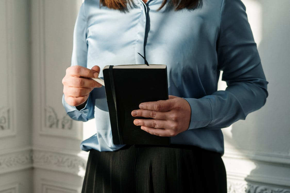 Woman in Blue Jacket Holding Black Tablet Computer