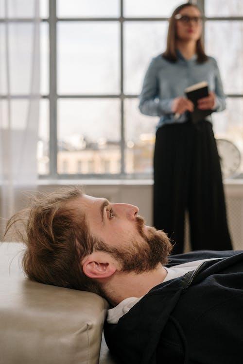 Man in Black Shirt Lying on Floor