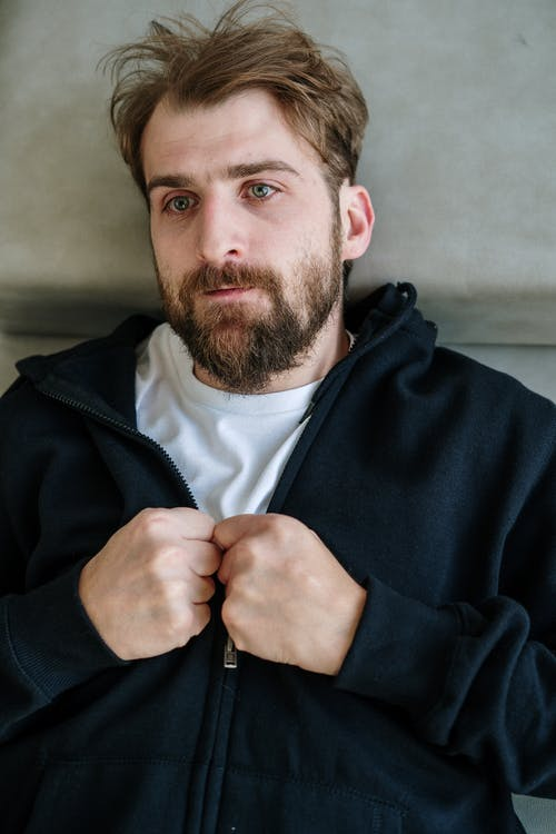 Man in Black Zip Up Jacket