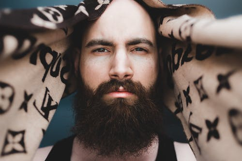 Pensive bearded man with headscarf