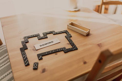 Composition of domino sets and small wooden box