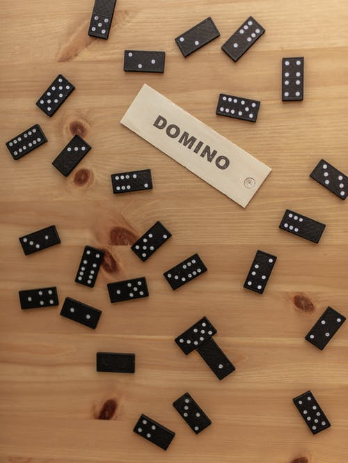 Domino pieces scattered on wooden table