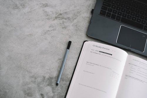 White Paper Beside Black Pen