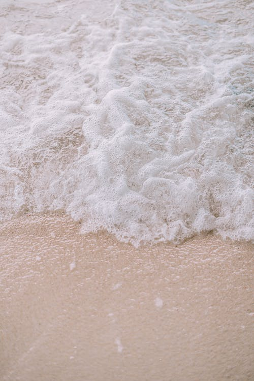 White Sea Waves on Brown Sand
