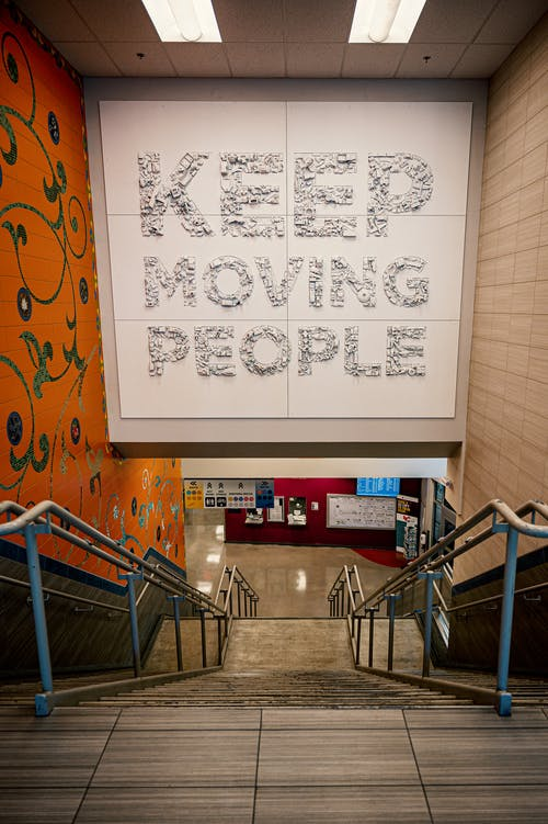 Staircase with Keep moving people inscription in shopping center