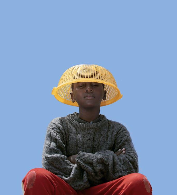Woman in Grey Long Sleeve Shirt Wearing Yellow Sun Hat