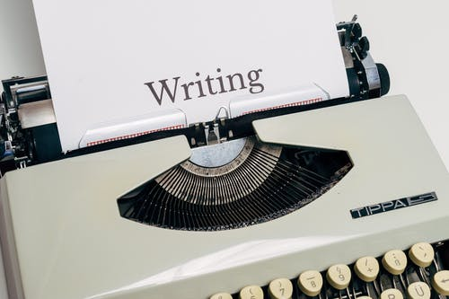 Vintage Typewriter With White Paper