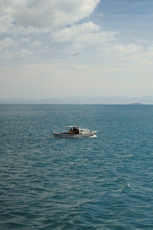 Small motorboat cruising on rippling sea