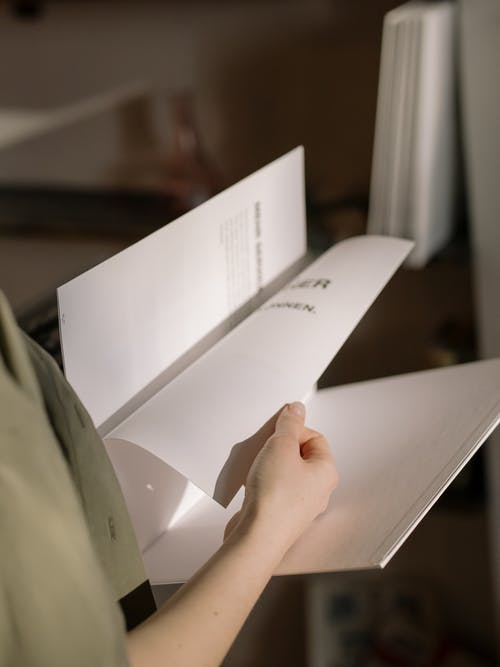 Person Holding White Printer Paper