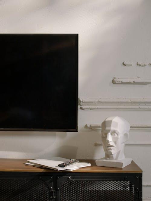 Black Flat Screen Tv Turned Off