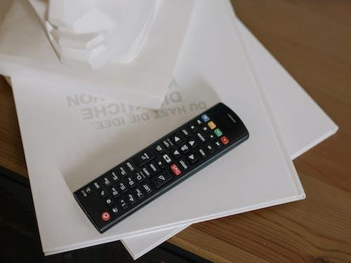 Black Samsung Remote Control on White Paper