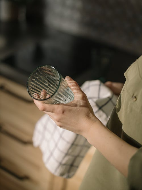 Person Holding Silver Round Coin