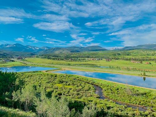 Magnificent landscape of green highlands and curvy abundant river