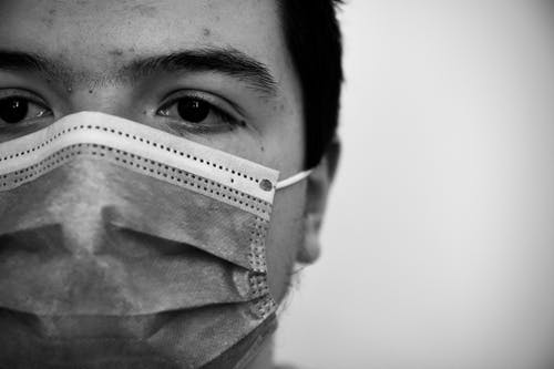 Grayscale Photo of Person Wearing Face Mask