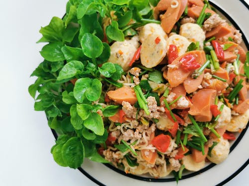 Appetizing healthy rice noodles and salmon salad