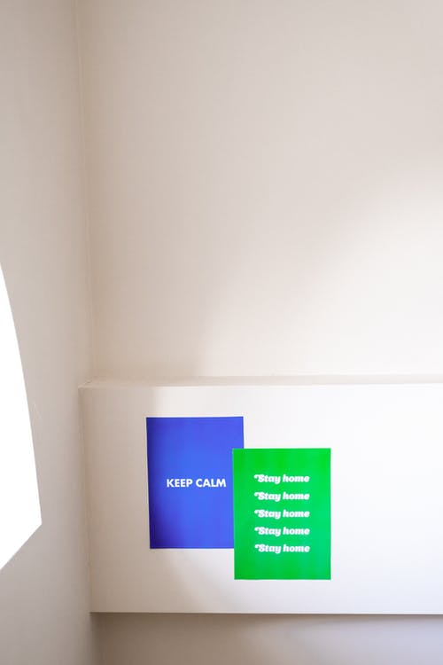 Blue and Green Slogans On White Wall