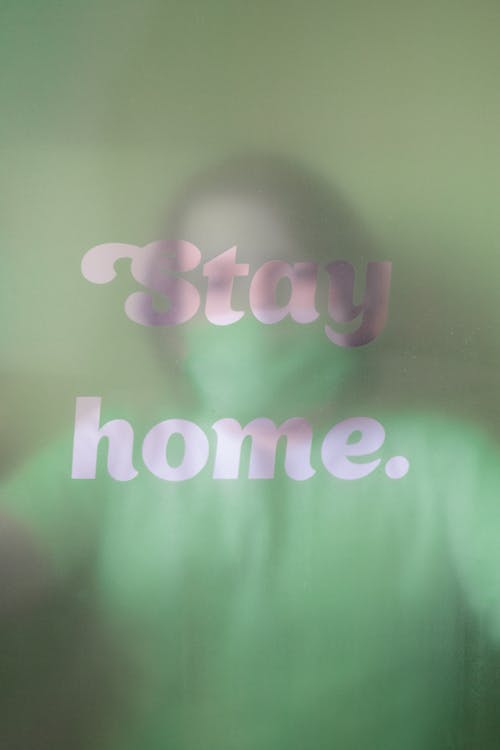 Stay Home Slogan With Blur Image Of Person