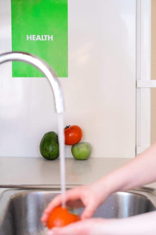 Person Washing Fruits And Vegetables