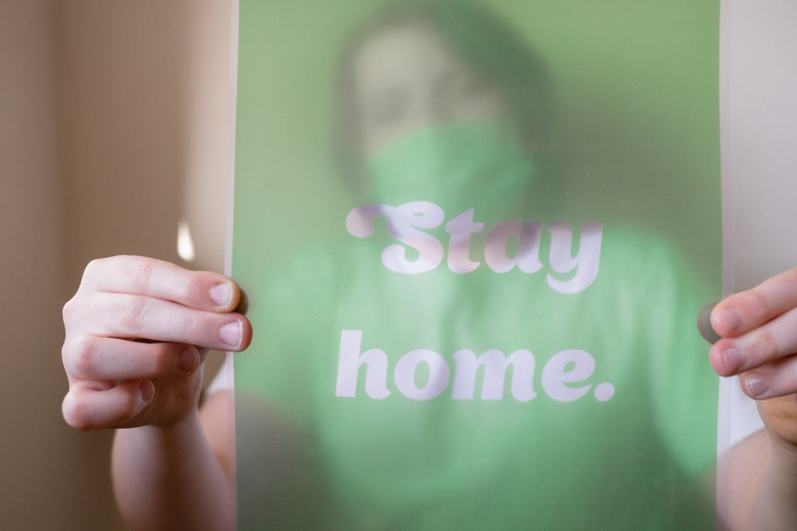 Person Holding Green and White Slogan