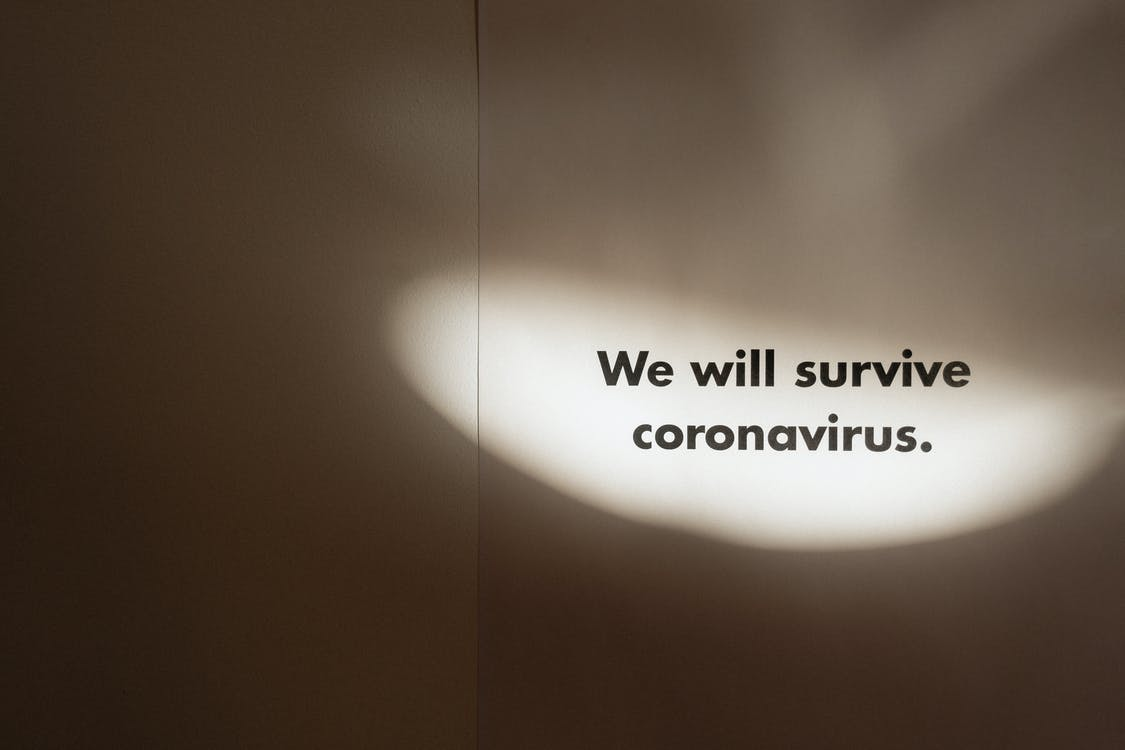 Grayscale Photo Of Slogan On Coronavirus