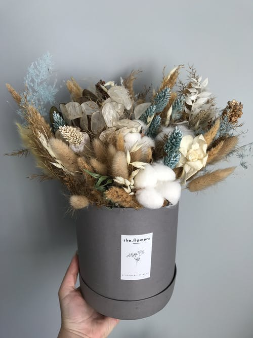 White and Brown Flower Bouquet in Gray Bucket