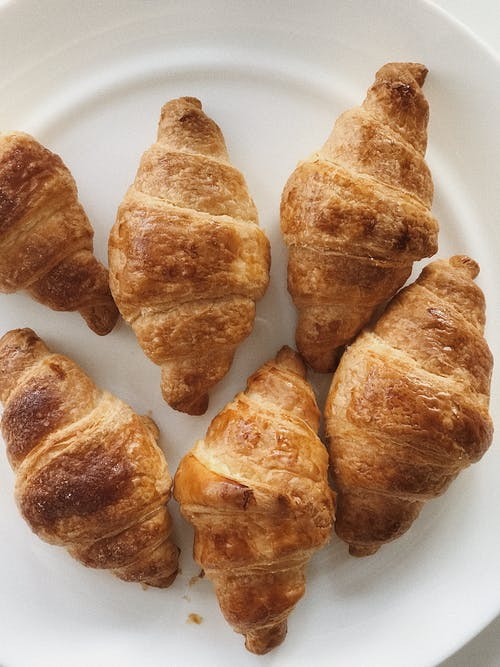 Croissants on White Ceramic Plate