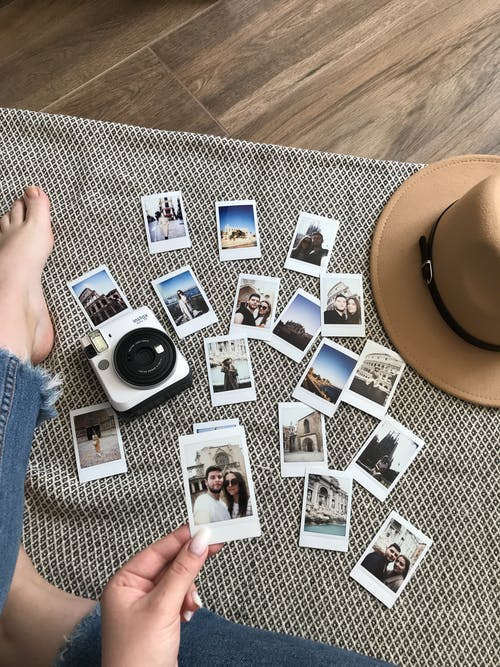 Person Holding An Instant Photo