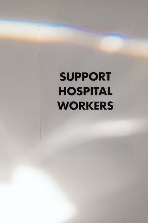 Support Hospital Workers Slogan On Blur Background