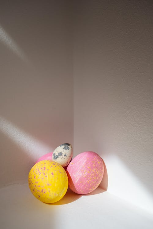 Pink and Yellow Easter Eggs With a Quail Egg
