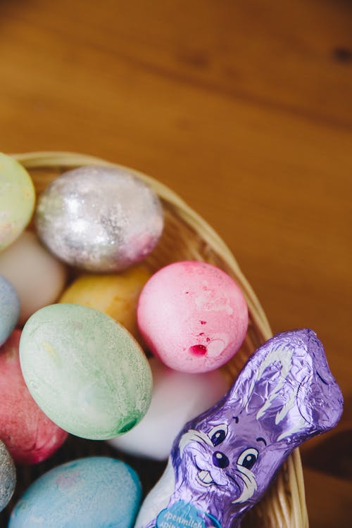 Pastel Colored Easter Eggs and Chocolate Rabbit