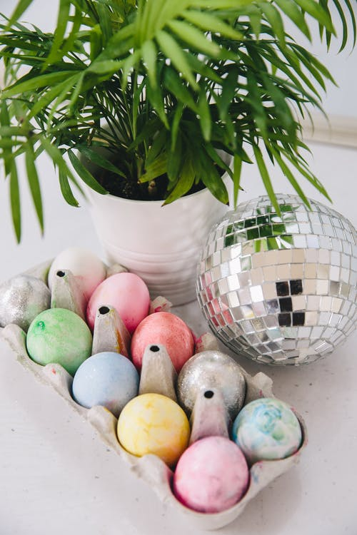 Easter Eggs and a Disco Ball next to a House Plant