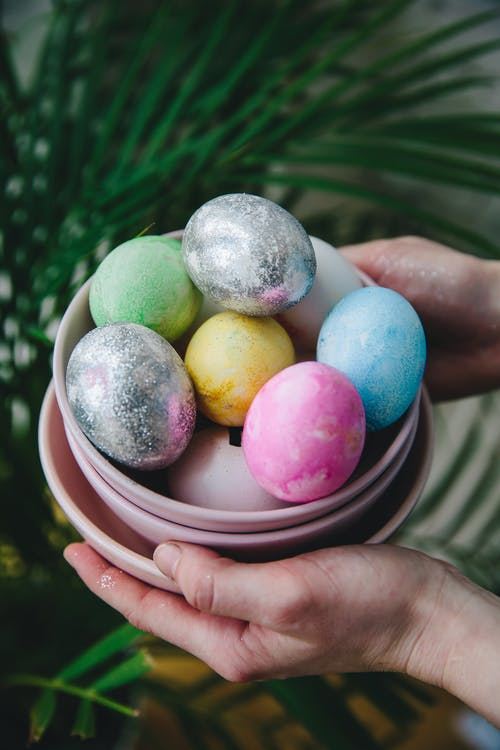 Person Holding a Bowl With Easter Eggs