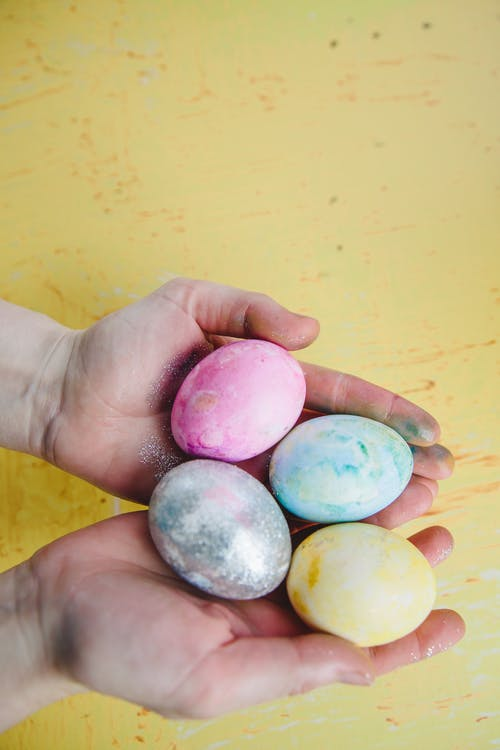 Person Holding Easter Eggs
