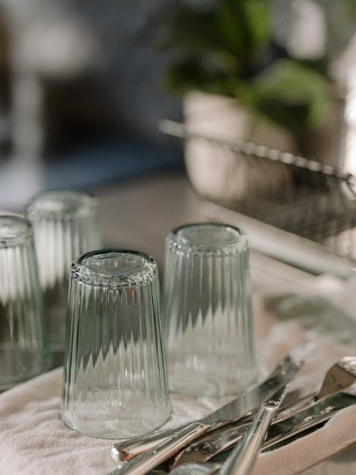 Clear Glass Condiment Shakers on Table