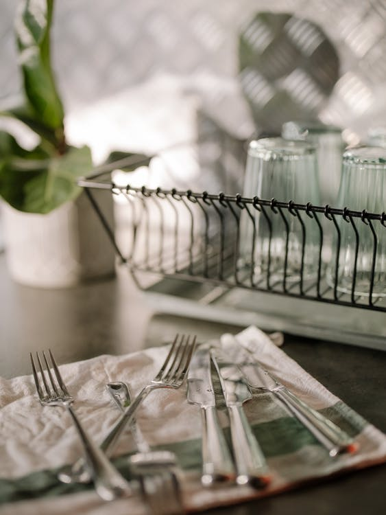 Stainless Steel Fork and Bread Knife on White Table