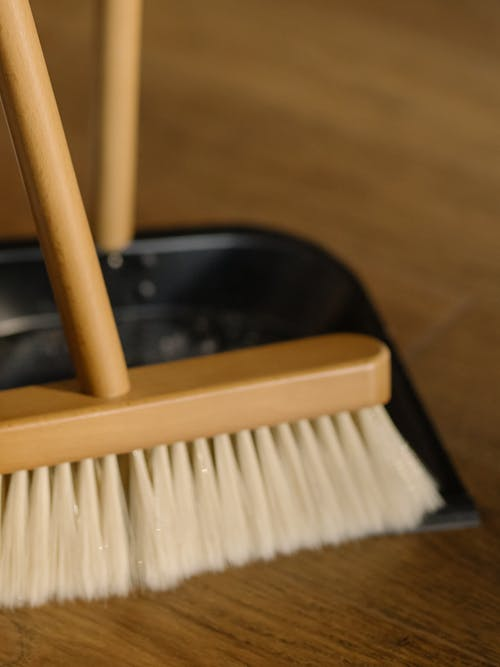 Brown Wooden Brush on Black Plastic Container