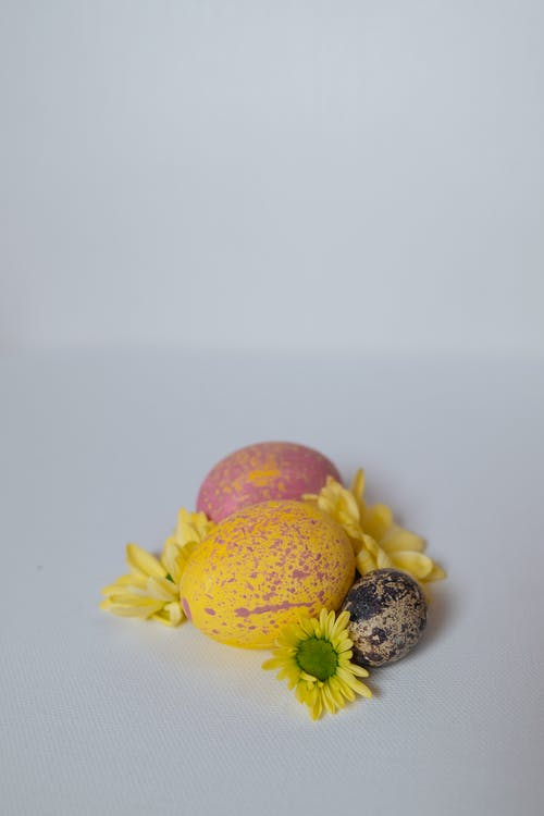 Yellow and Pink Fruit on White Surface